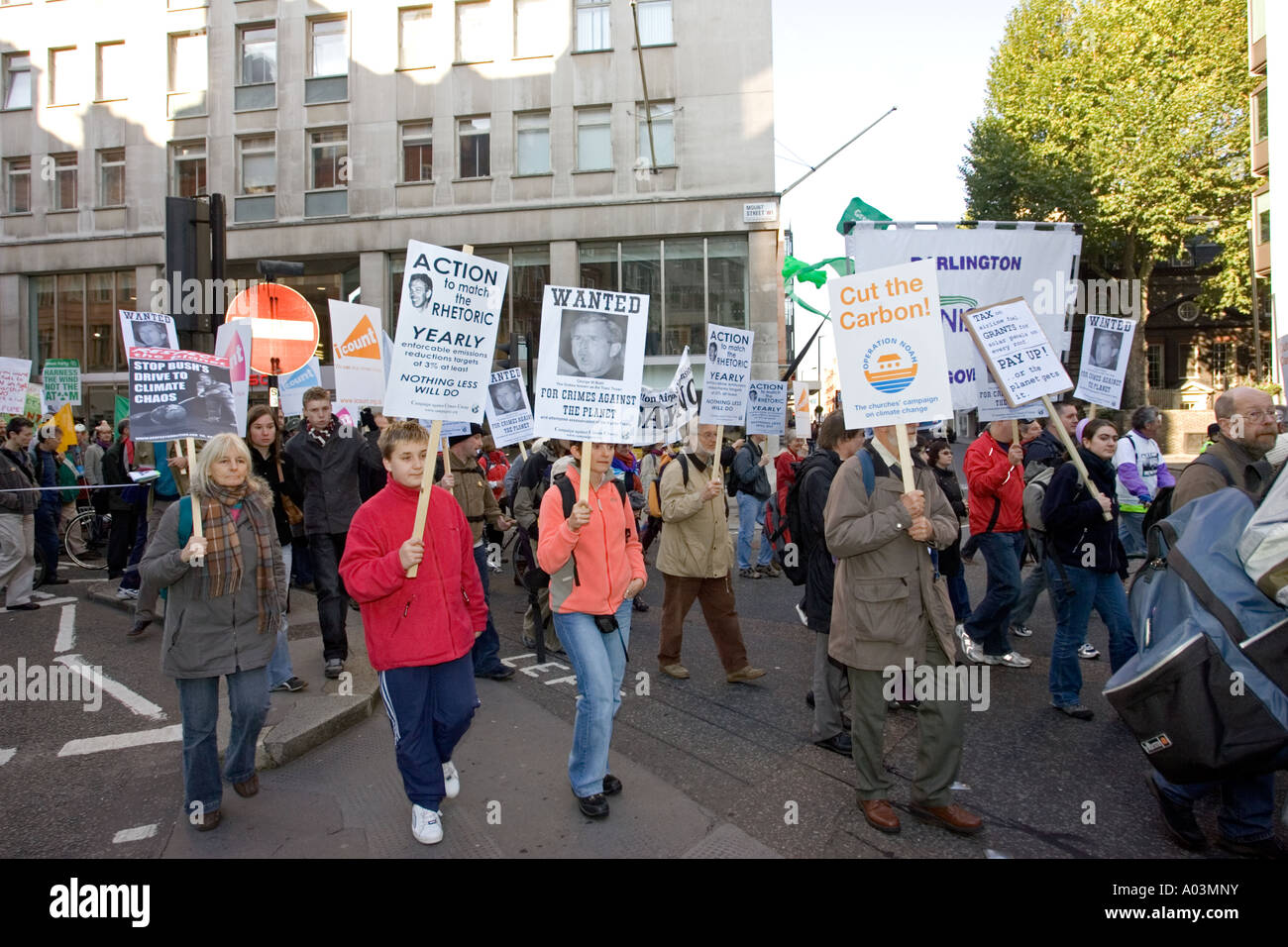Protesters marching through London carrying Stop Climate Chaos placards on National Rally London 2006 - Stock Image