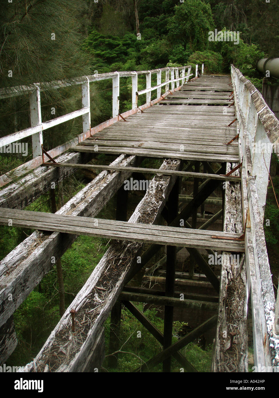 A rotting and abandoned wooden bridge to nowhere - Stock Image