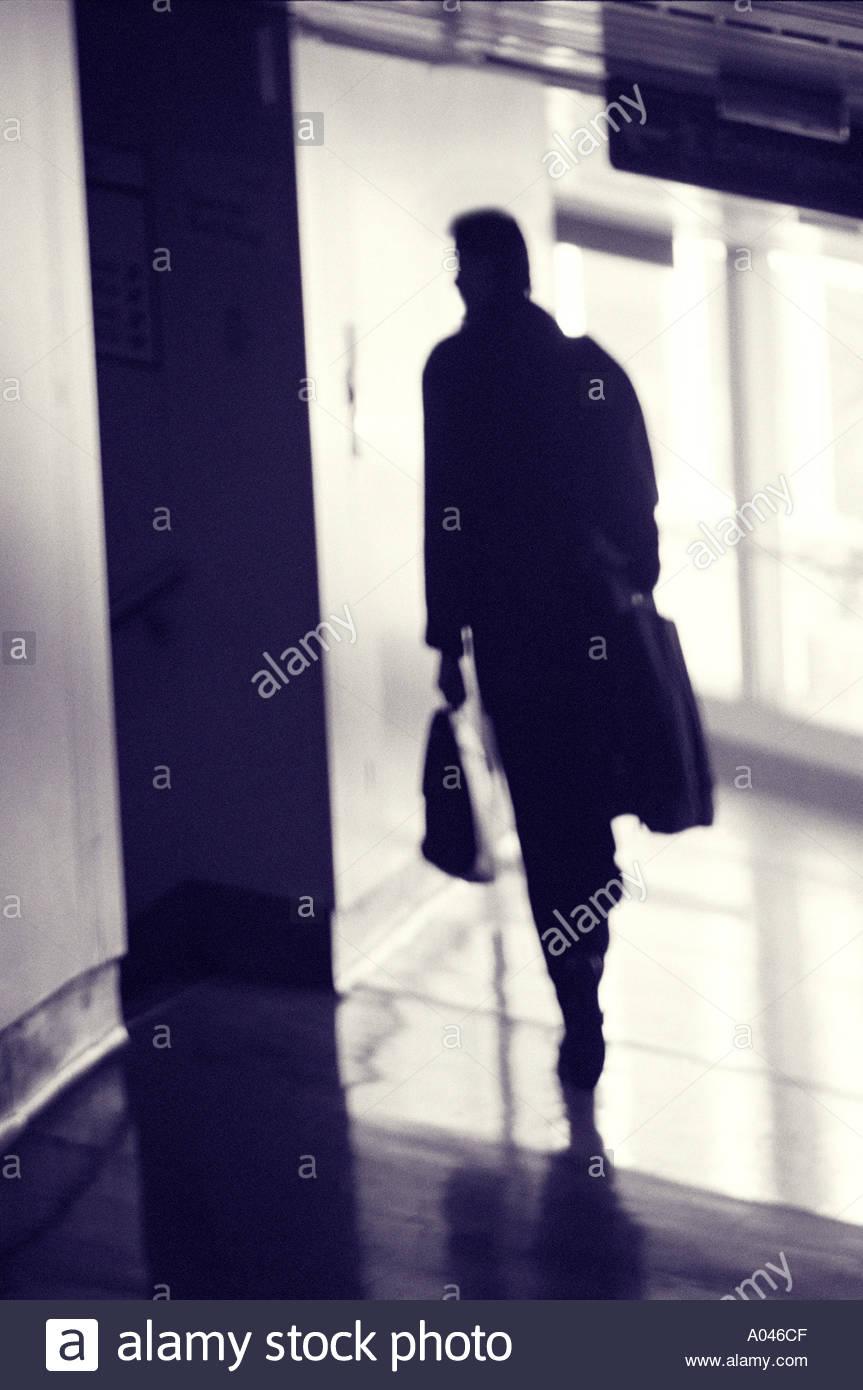Man in airport corridor - Stock Image