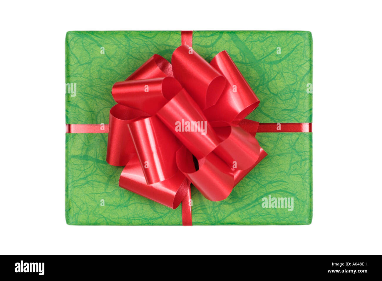Gift Wrapped Present with Green Paper and a Red Ribbon - Stock Image