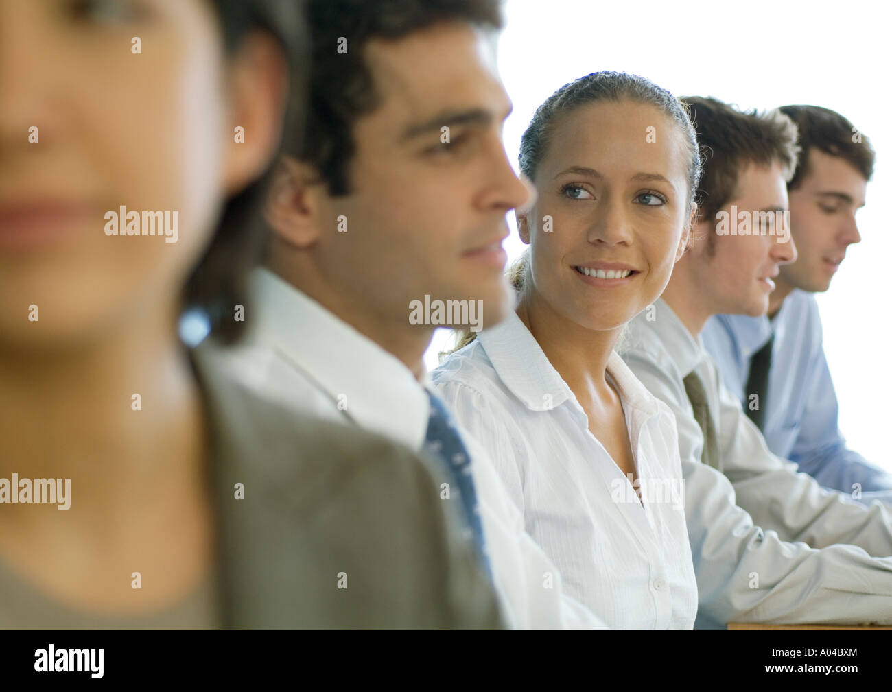 Business colleagues having meeting, focus on woman - Stock Image