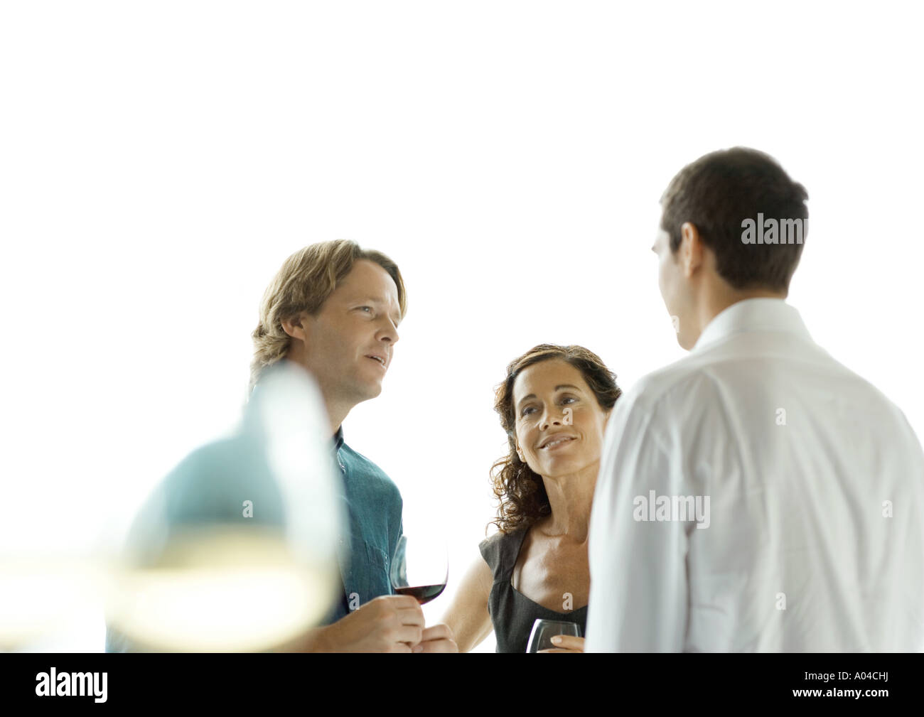People talking during cocktail party - Stock Image