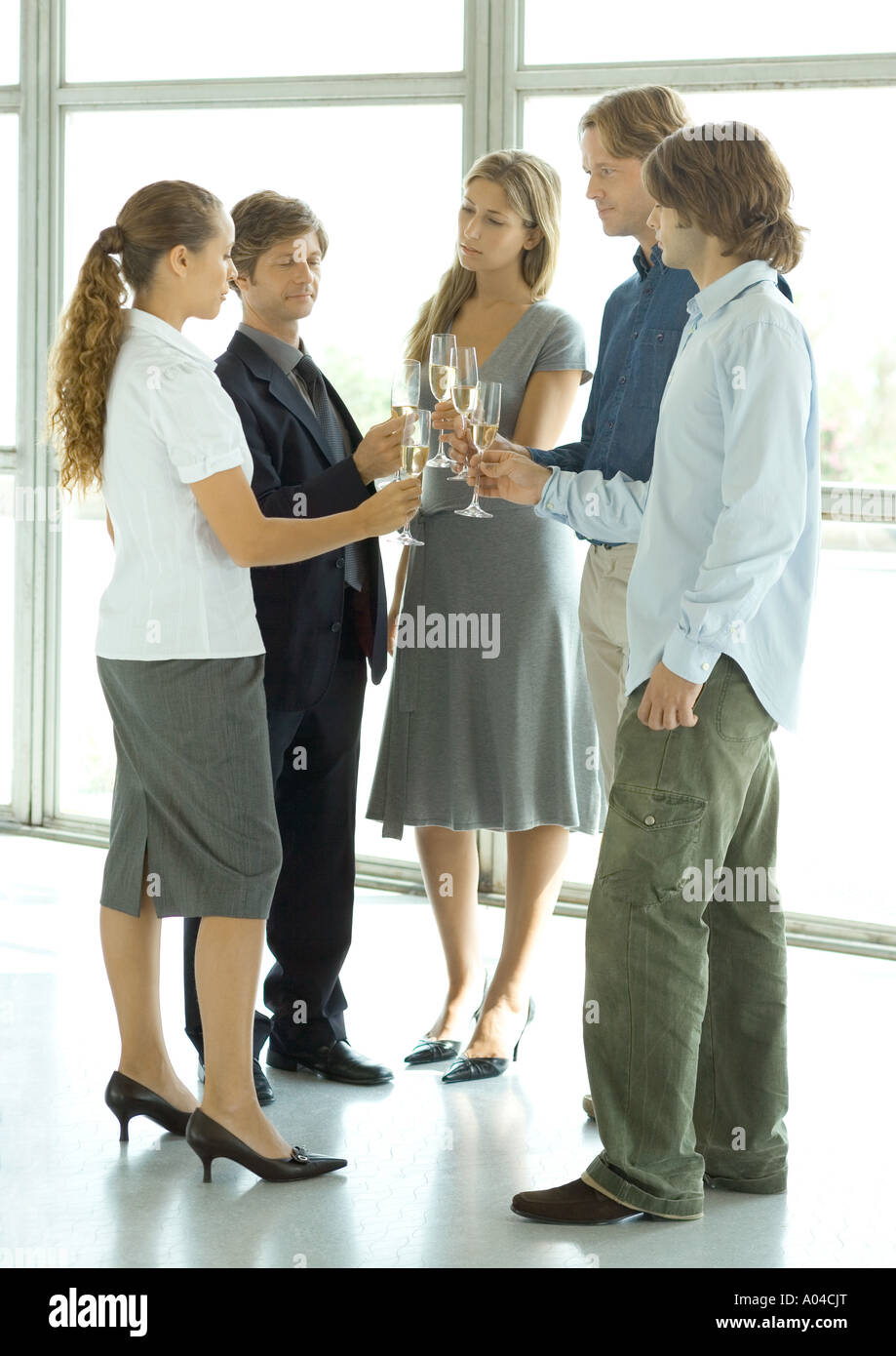 Group of executives making a toast during cocktail party - Stock Image
