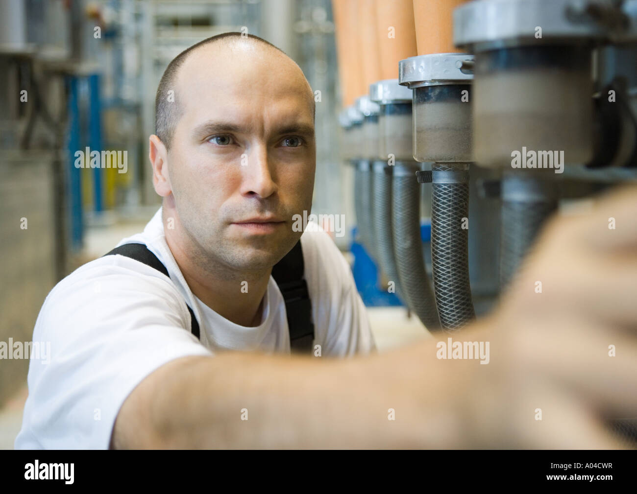 Worker in paper mill - Stock Image