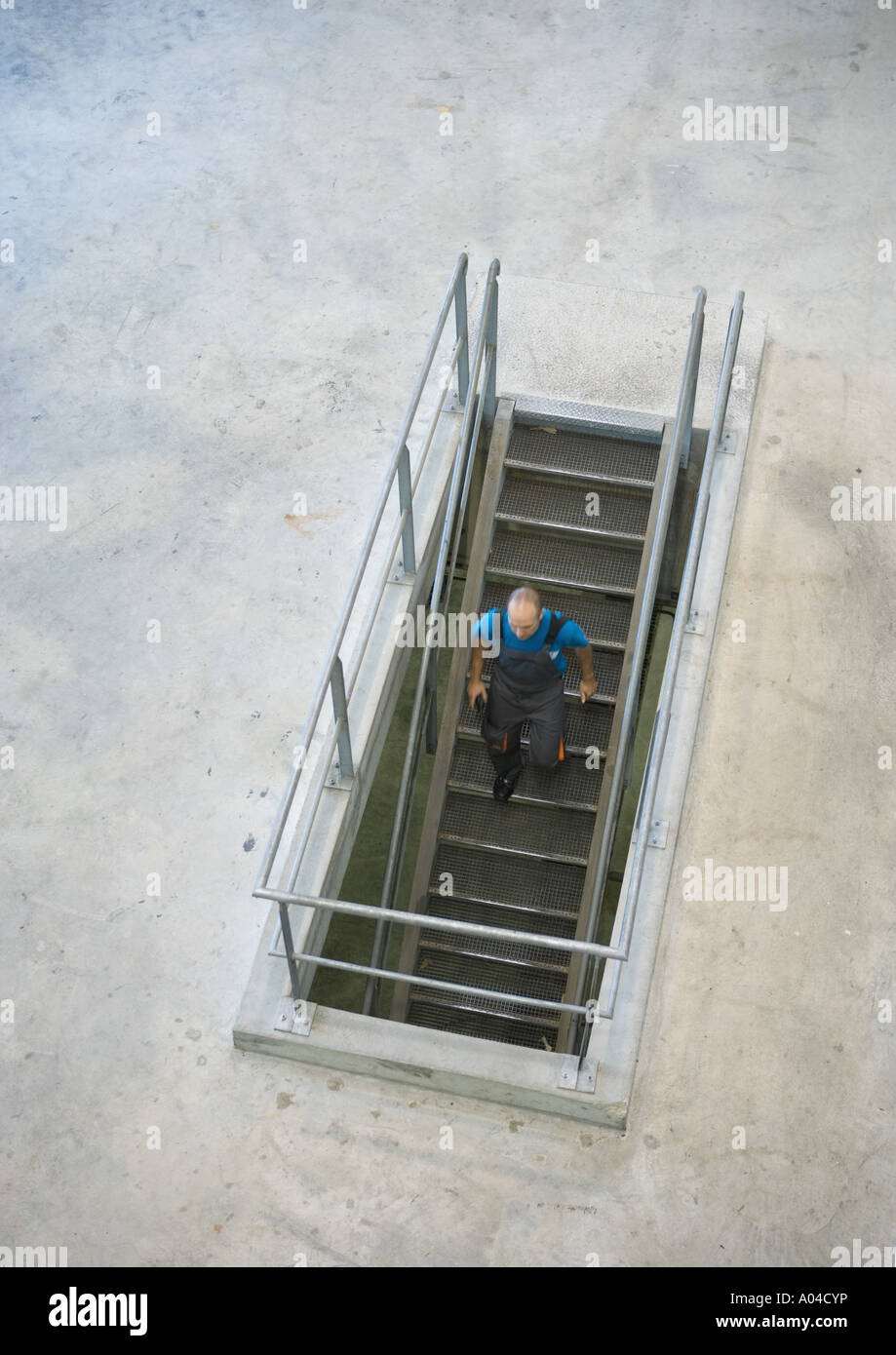 Man Going Down Stairs High Angle View Stock Photo