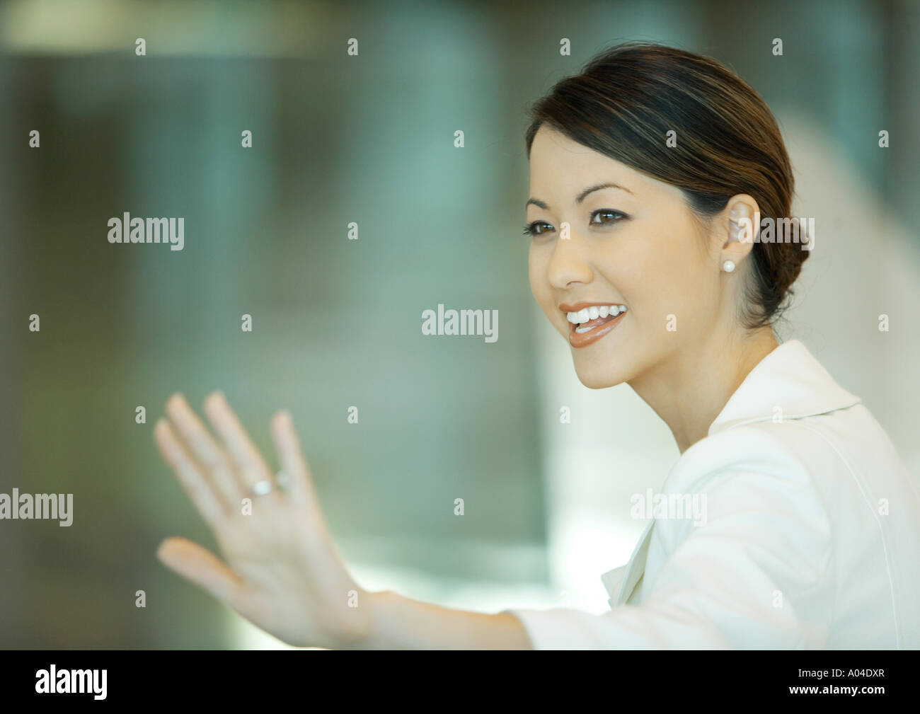 Woman waving - Stock Image