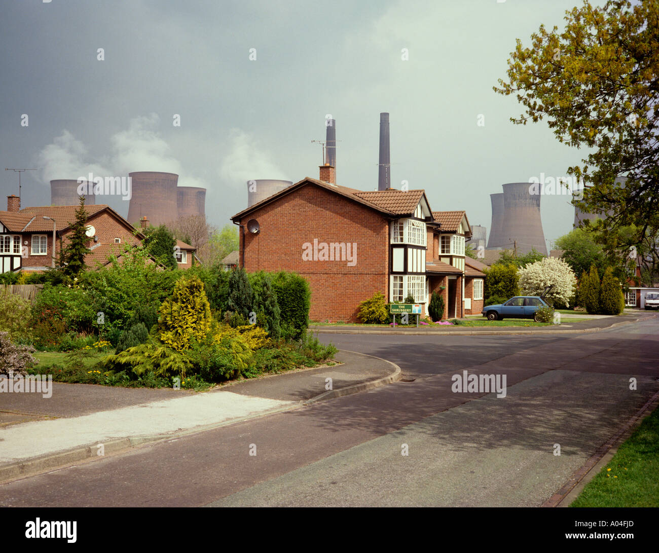 Environment houses in shadow of power station - Stock Image