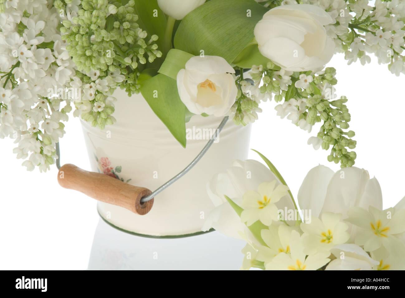 Flower Arrangement Of White Lilac White Tulips Andprimrose Stock
