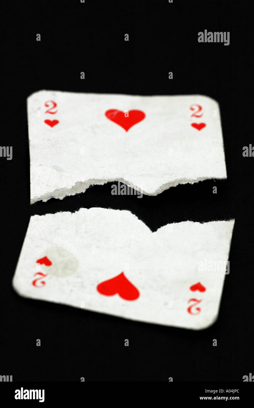 Two of hearts playing card torn in half - Stock Image