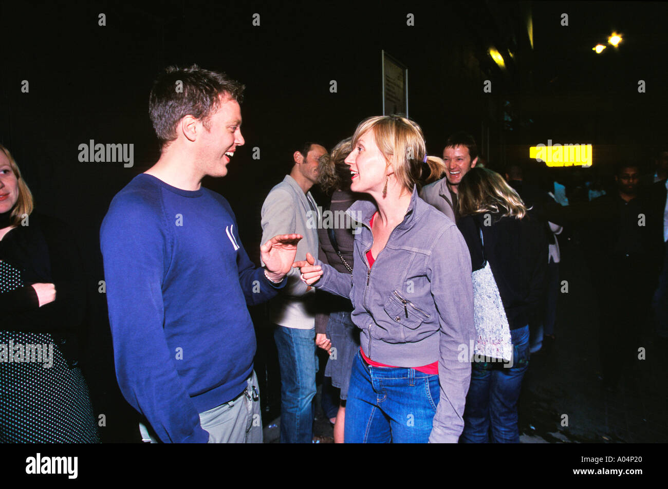 Couple in queue outside 333 nightclub in Shoreditch East London - Stock Image