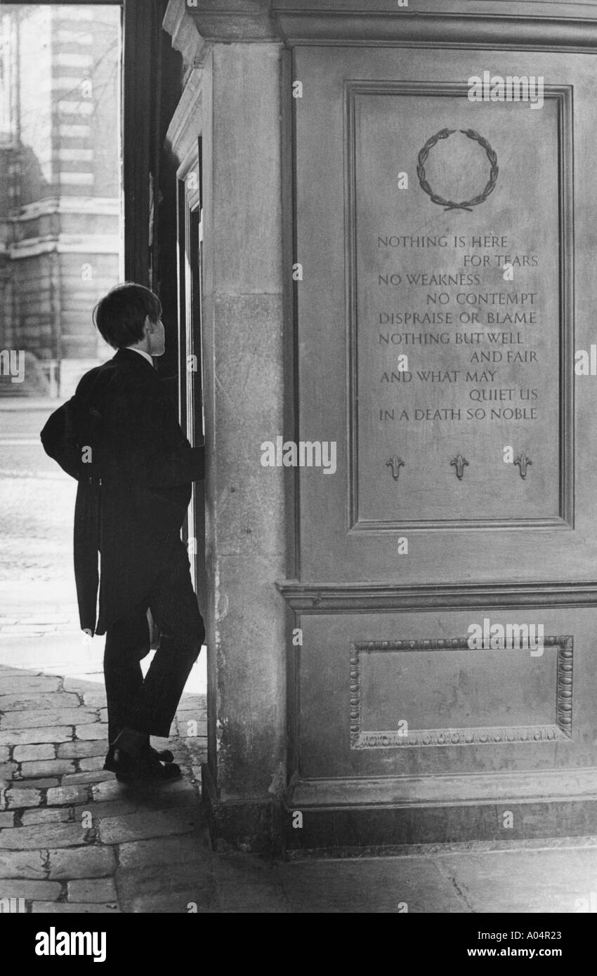 Young male student of Eton College outside the gates of the school in Windsor - Stock Image