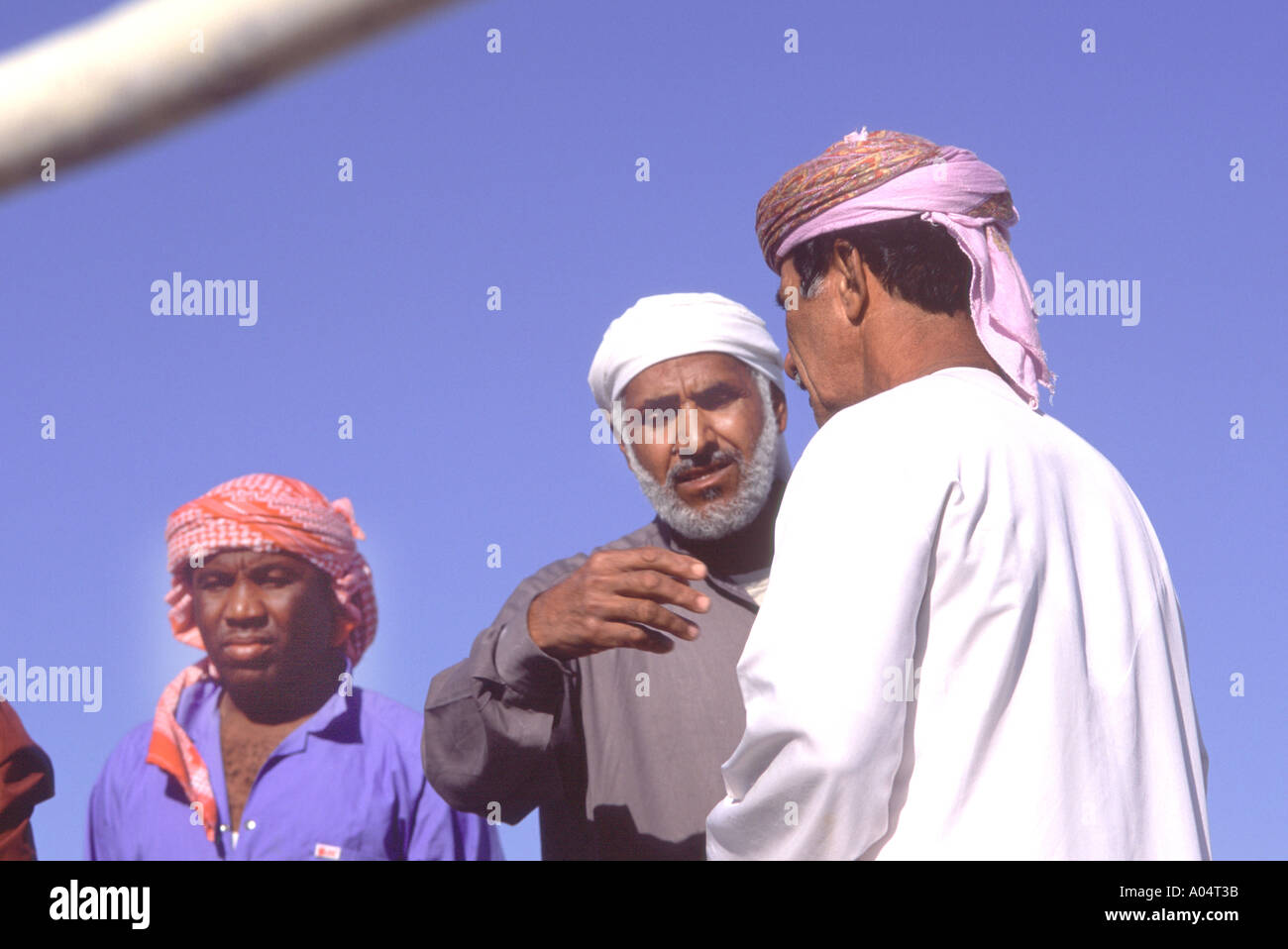 Oman, Musandam. Omani seamen in the port of Khasab. They run dhows - Stock Image