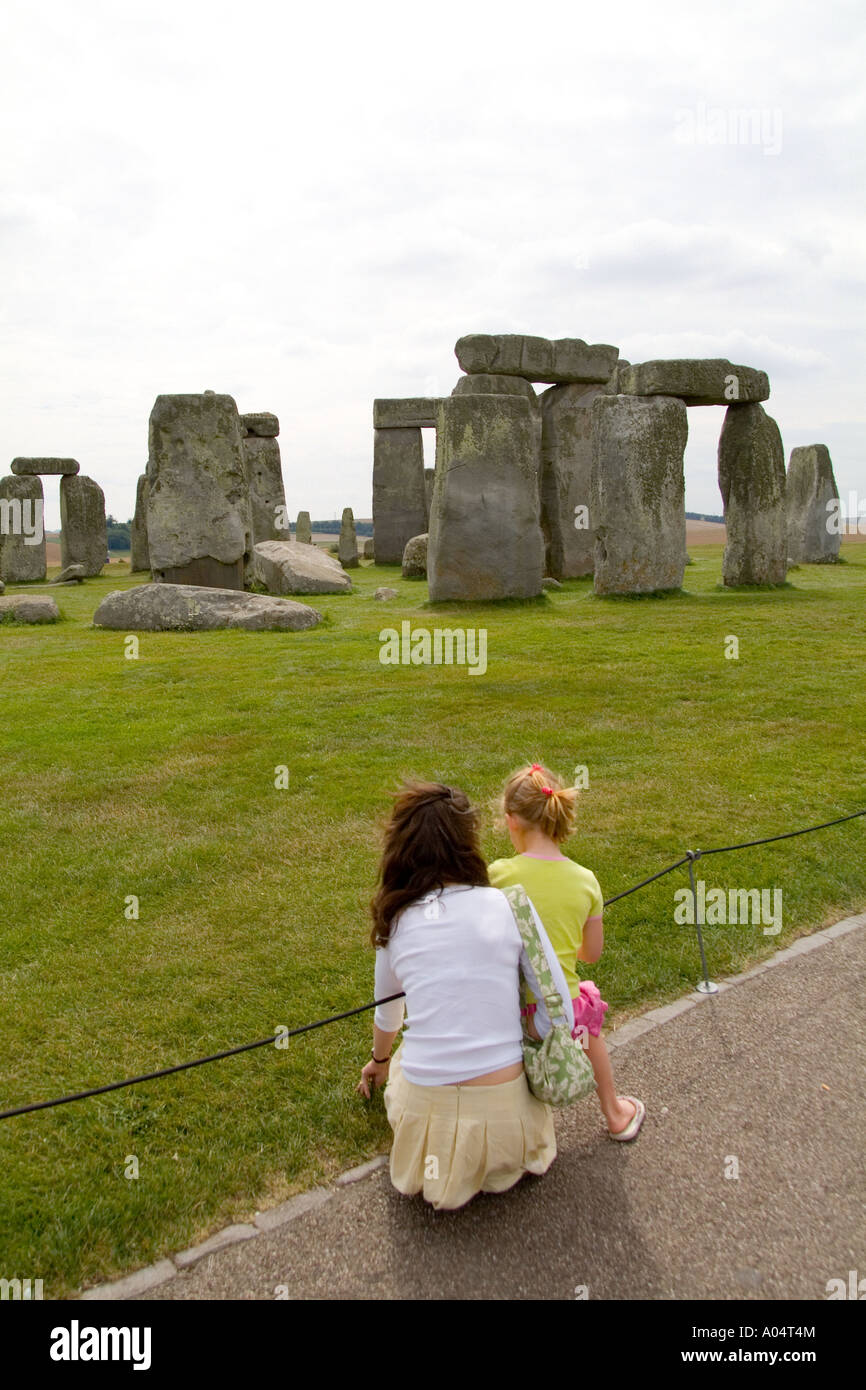 Mother explaining the meaning of the world famous Stonehenge monument in England Great Britian - Stock Image