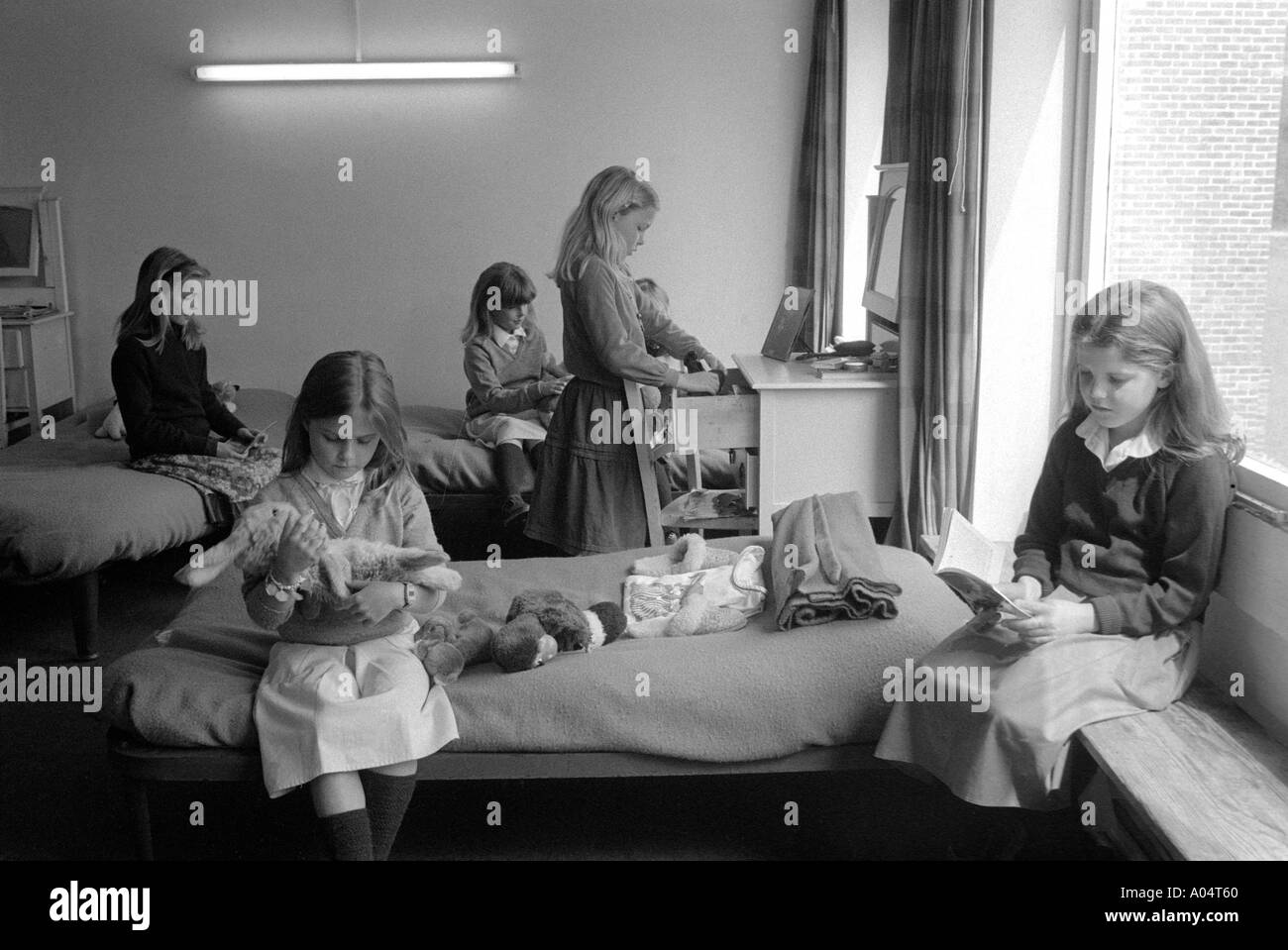 Kids chatting at night in girls dormitory at private boarding school - Stock Image