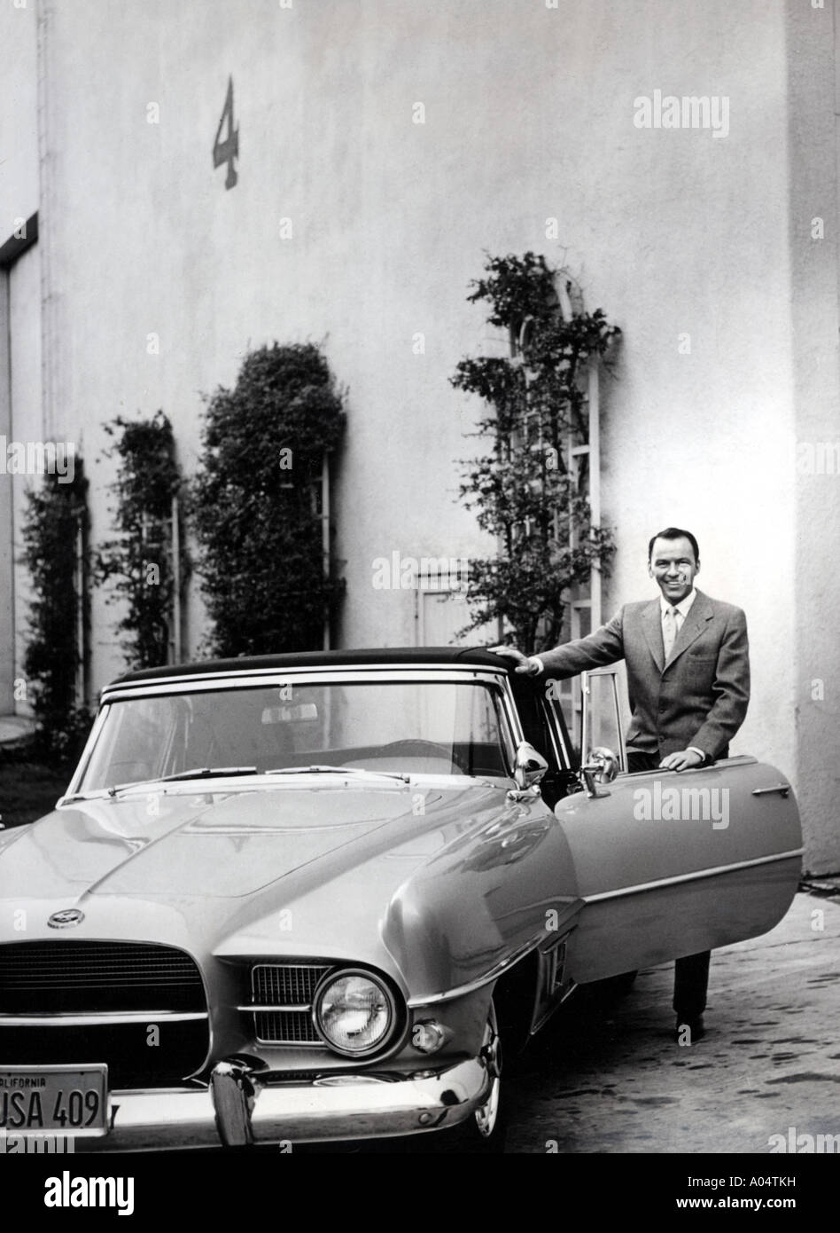 FRANK SINATRA about 1959 with his very rare Dual Ghia convertible of which only 117 were produced - Stock Image