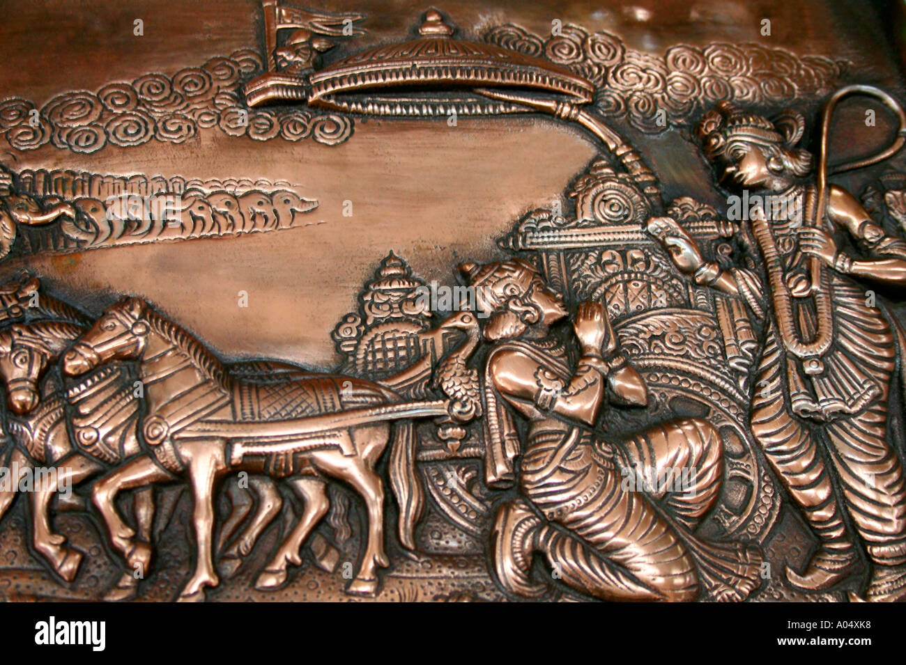 Indian handicraft brass plate depicting the scene from the famous bhagvat geetha - Stock Image