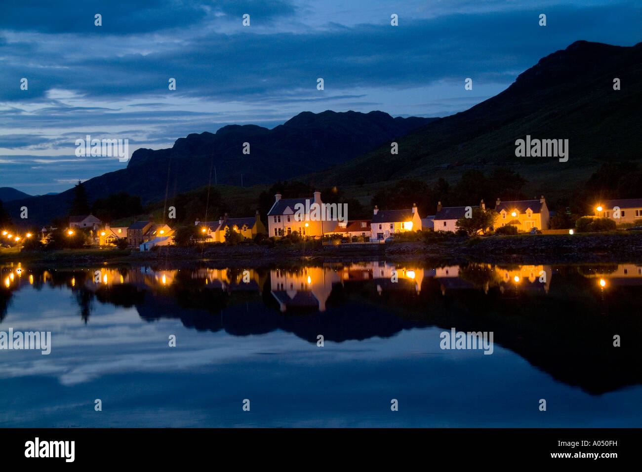 Beautiful night photo of small village of Dornie with refections in Western Highlands Scotlands - Stock Image