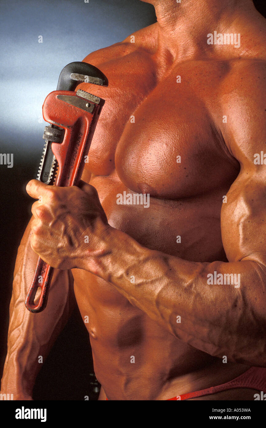 Muscle Man Athlete Showing Muscular Arms And Pectoral Muscles And