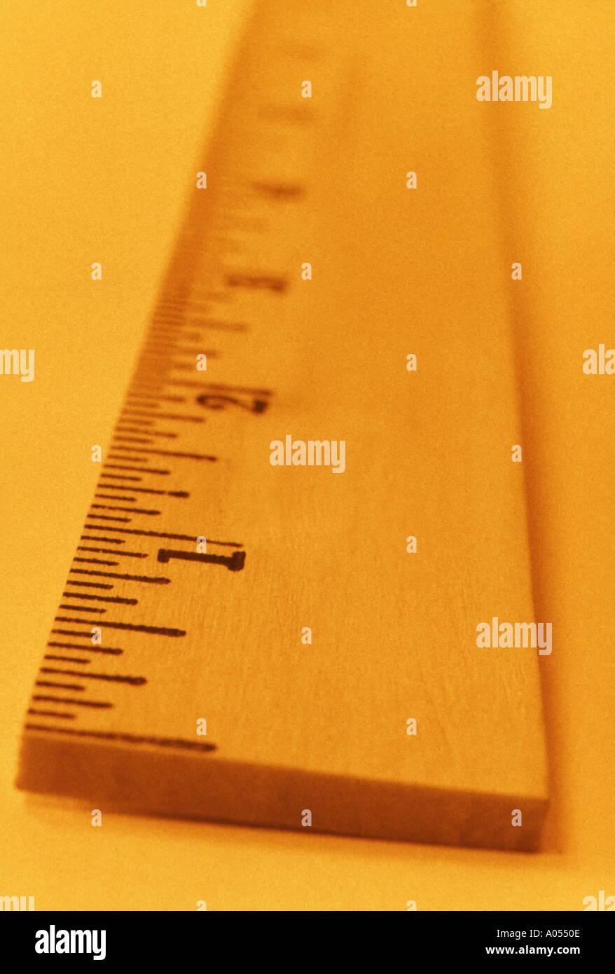 End Of Yardstick Orange Toned Selective Focus - Stock Image