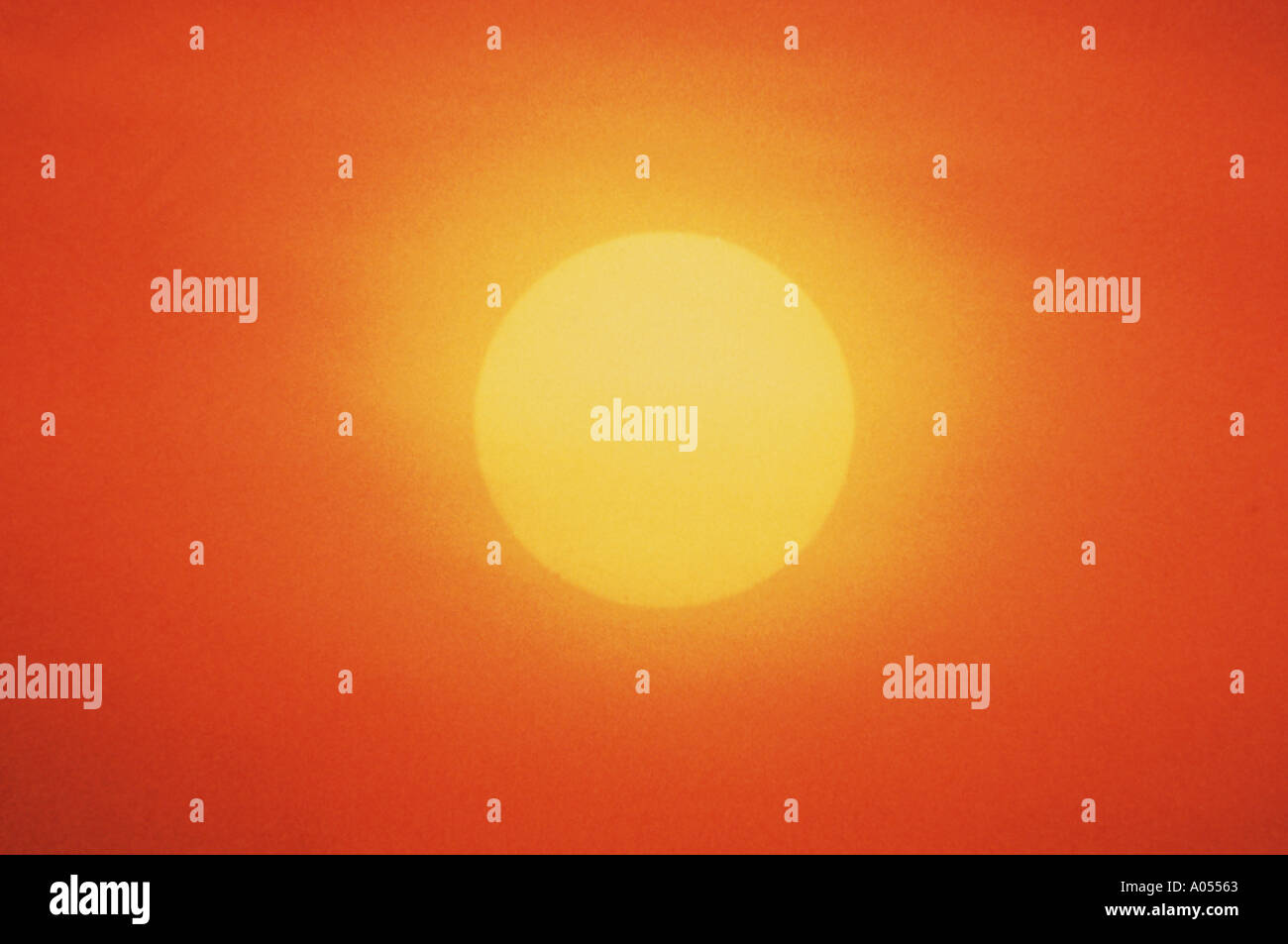 big yellow sun in a red sky sundown evening glow background - Stock Image