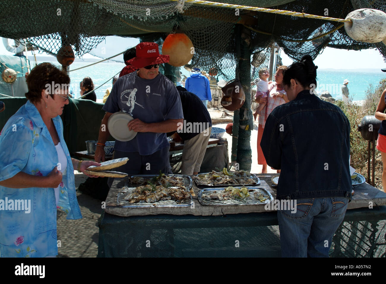 Beach restaurant at Langebaan western Cape South Africa RSA guests helping themselves - Stock Image
