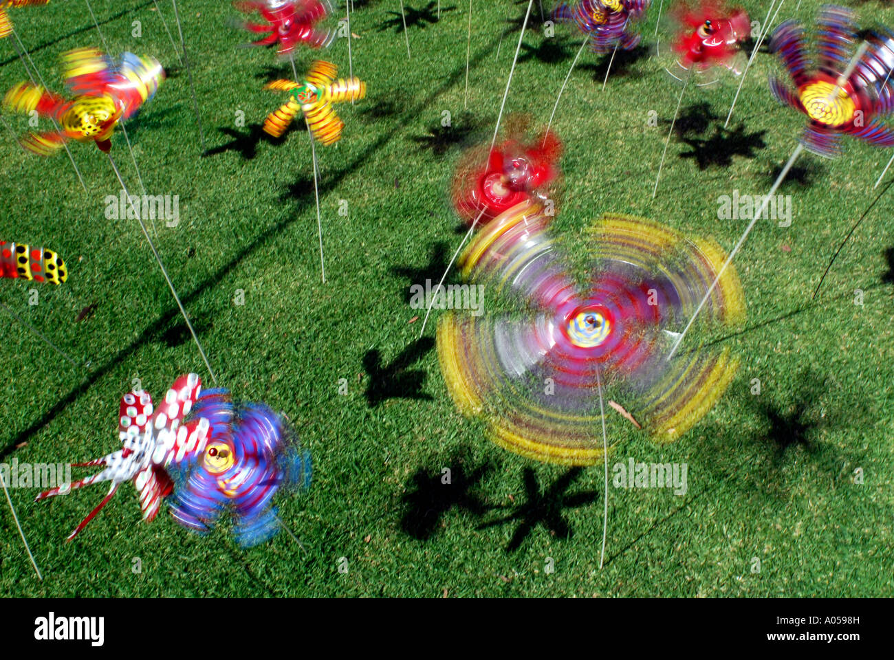 recycled plastic bottles made into spinning toys - Stock Image