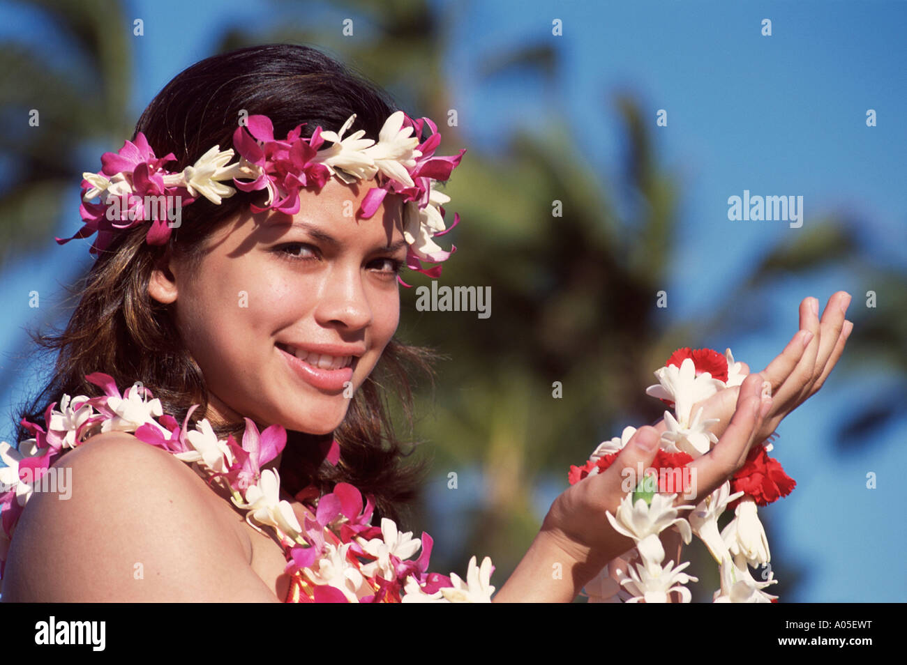 Hawaiian Girl With Flower Lei, Day - Stock Image