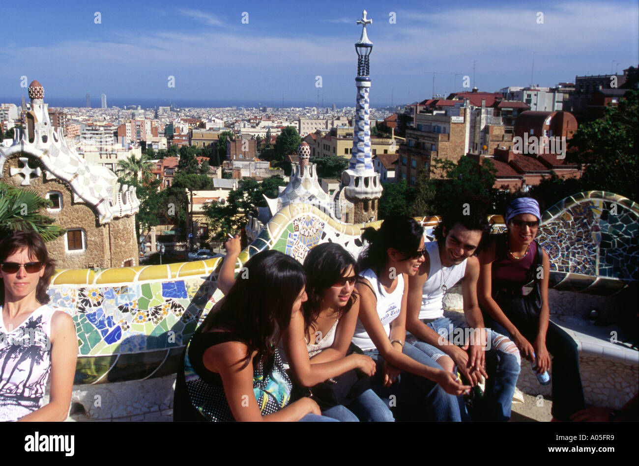 Barcelona Parc Guell by Gaudi public parc with colorful masaics people teenager Stock Photo