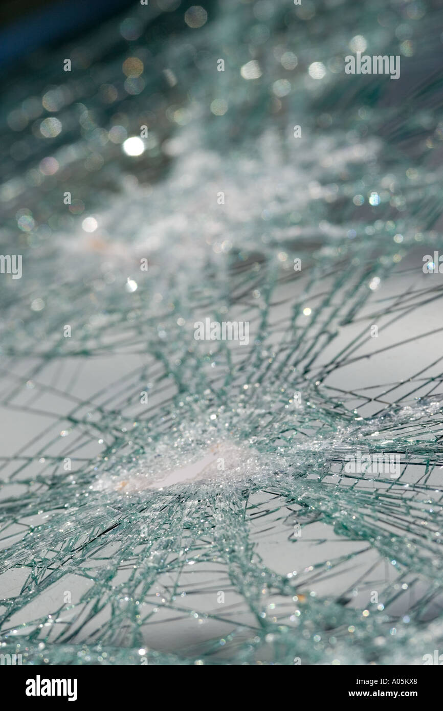 Close-up of cracked car windshield - Stock Image
