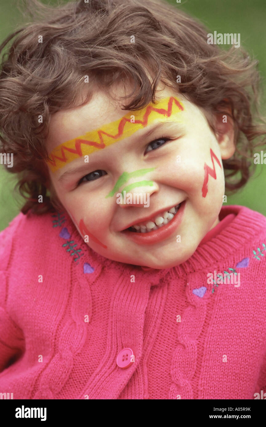 4 5 Year Old Girl With Face Paint Smiling At Camera Stock Photo