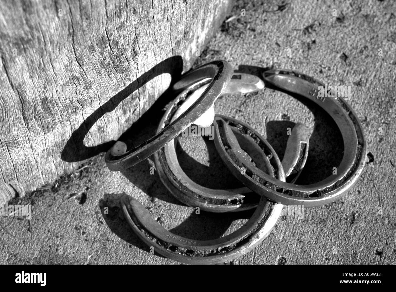 black and white of horseshoes and a barrel - Stock Image