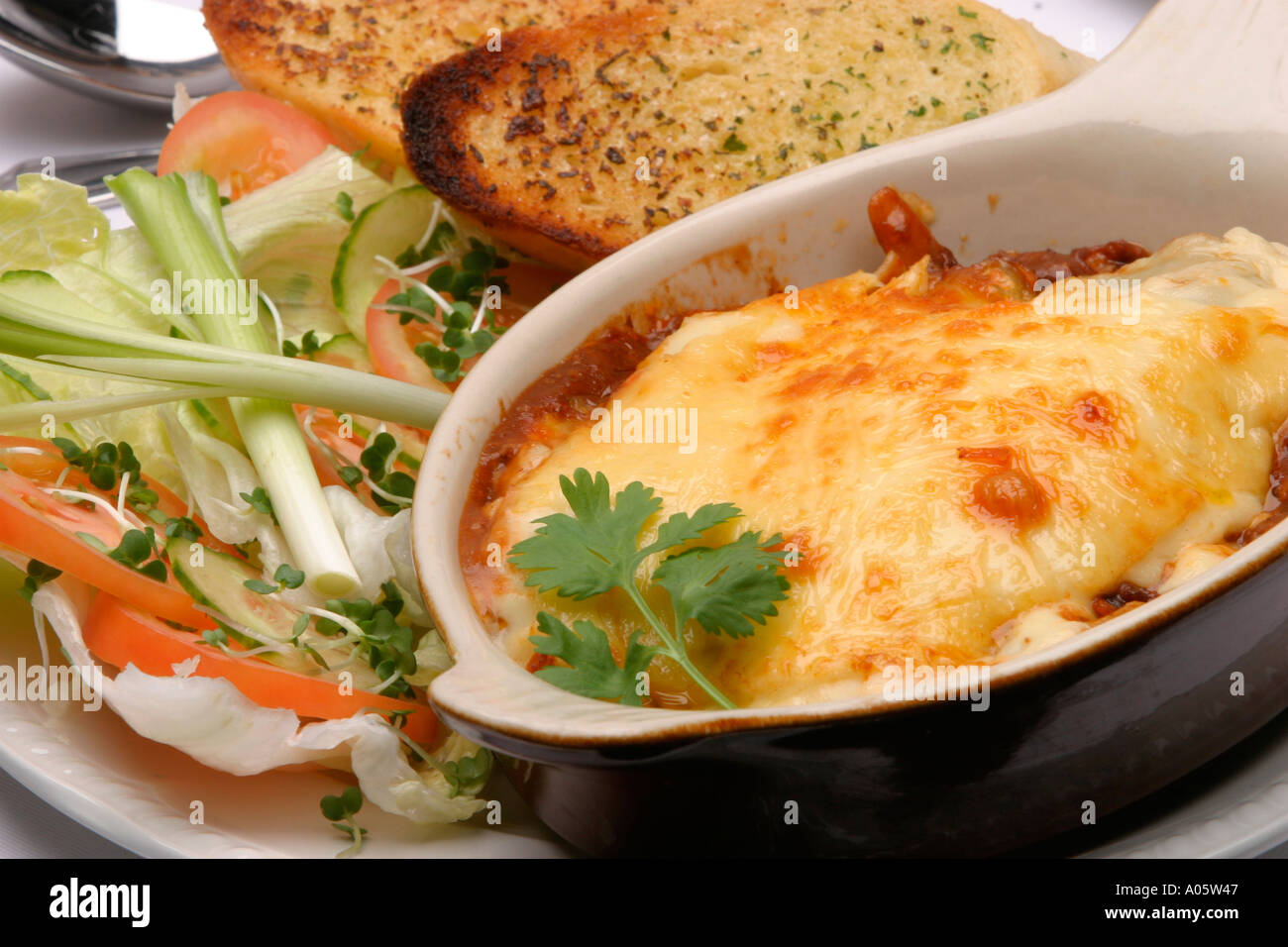 Food Italian Main Course Lasagne And Salad With Garlic Bread