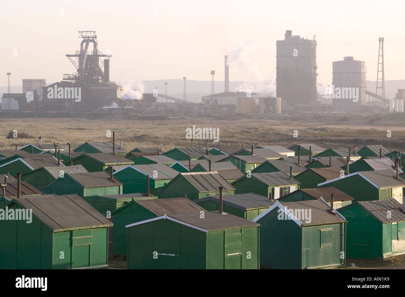Fishermens huts at South Gare, Redcar, Teeside, with the Corus Steelworks in the back ground, England - Stock Image