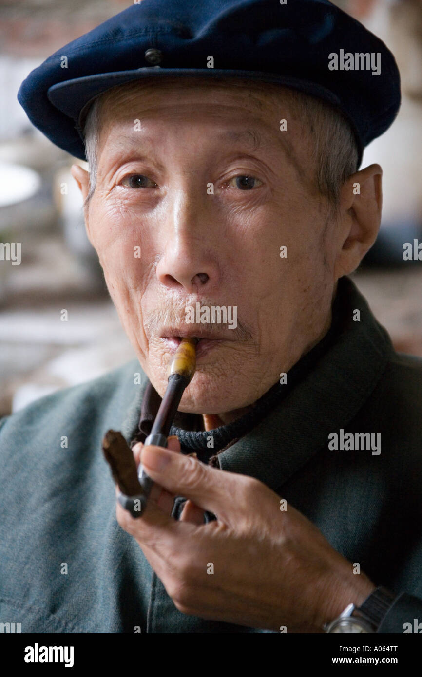 ac43534d9 Senior Asian Man Smoking Pipe Stock Photos & Senior Asian Man ...