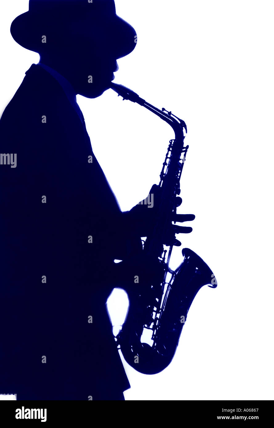 Silhouette of man playing a saxophone. - Stock Image