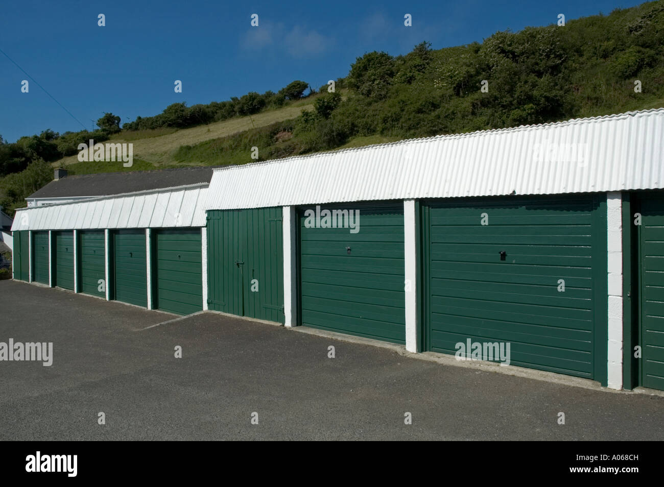a row of lock up garages for rent in portloe in cornwall,england - Stock Image
