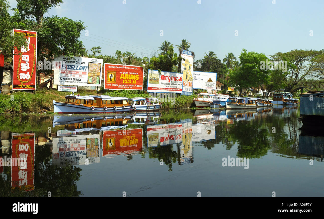 India Kerala Alleppey North canal advertising hoardings reflected in water - Stock Image