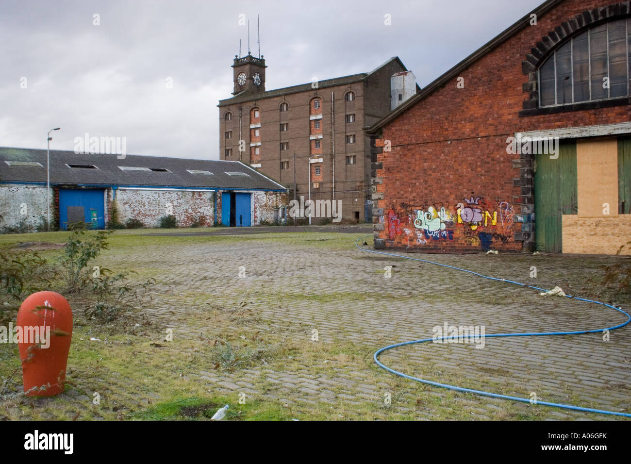 Abandoned dockland industrial warehouses and factories in Dundee, UK - Stock Image