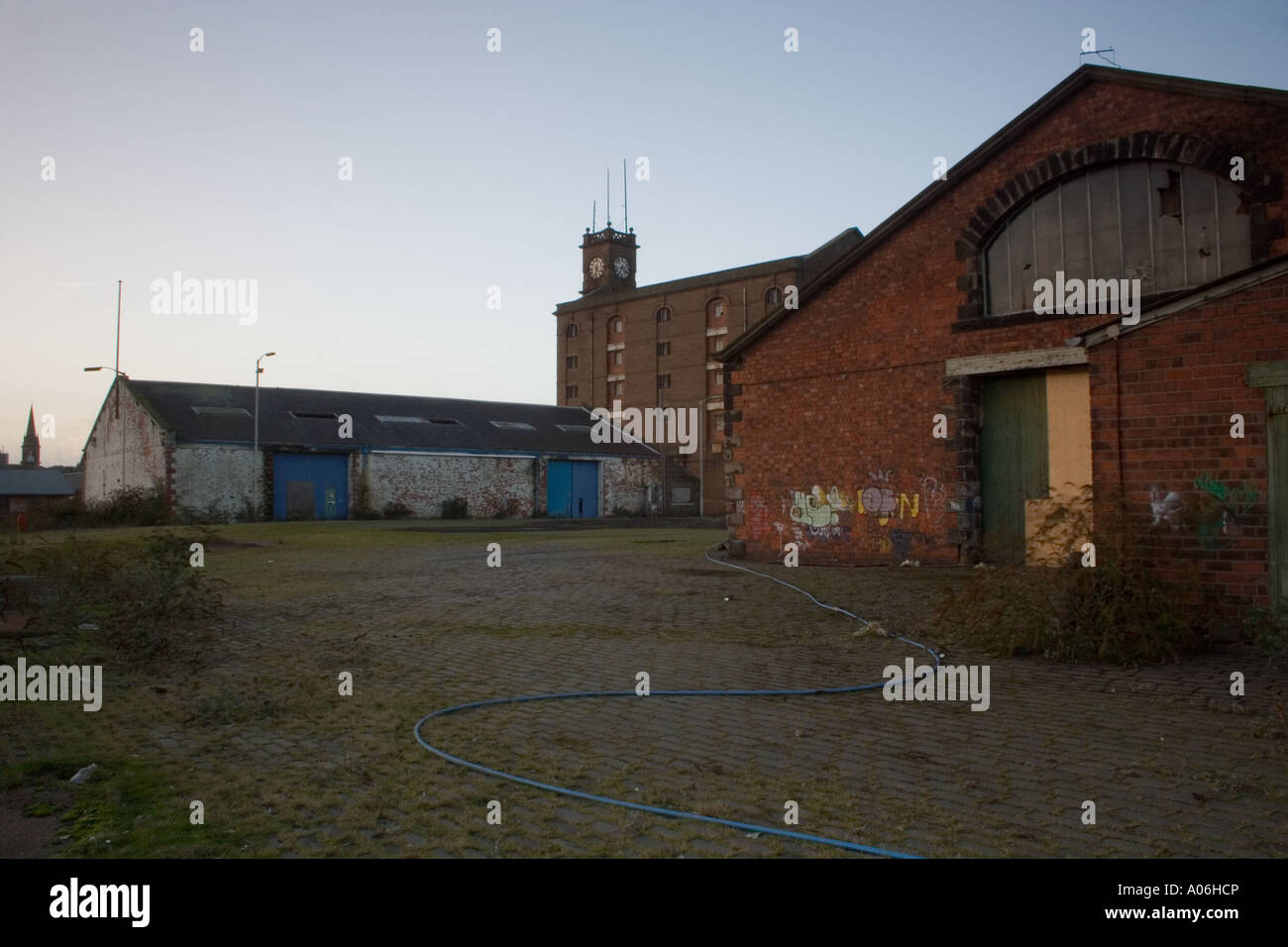 Derelict warehouses along the docklands in Dundee, UK - Stock Image