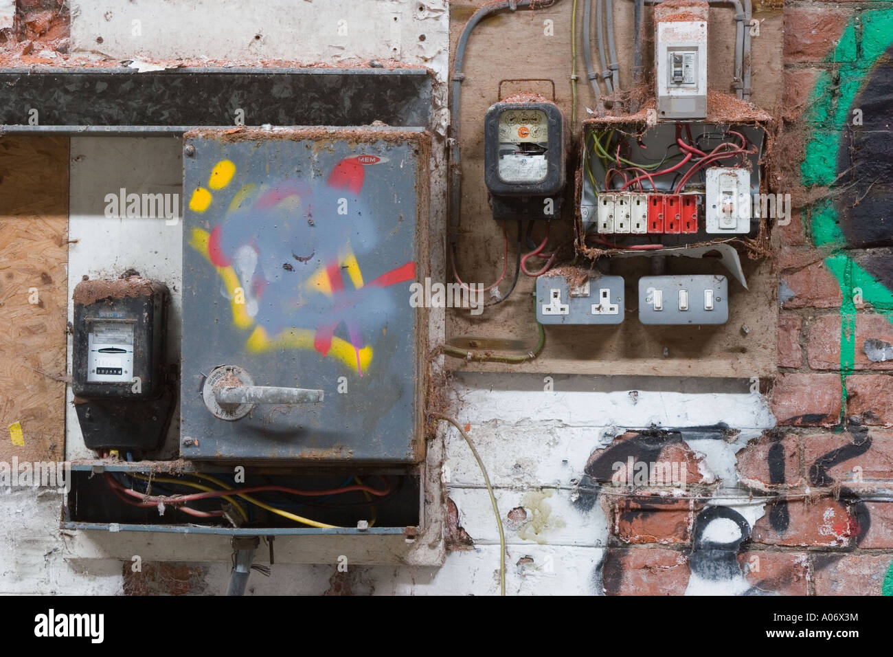 Old electrical installation fuse board and distribution board with wylex  switchgear. - Stock Image