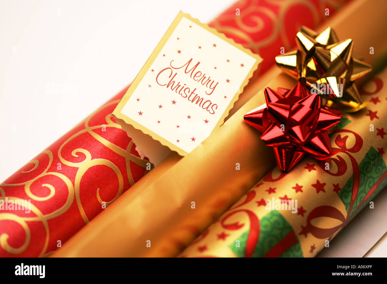 Rolls of festive seasonal xmas christmas gift present wrapping paper rolls of festive seasonal xmas christmas gift present wrapping paper and matching red gold ribbon bows and gift tag negle Choice Image