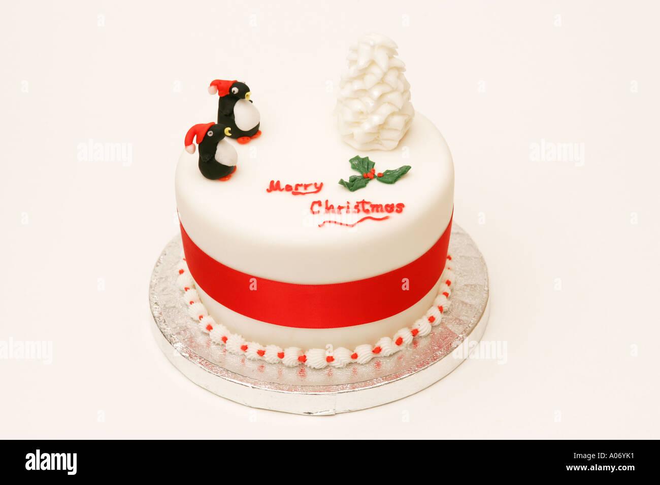 offset traditional seasonal festive british xmas cake with novelty iced tree and penguin decorations merry christmas - British Christmas Cake Decorations