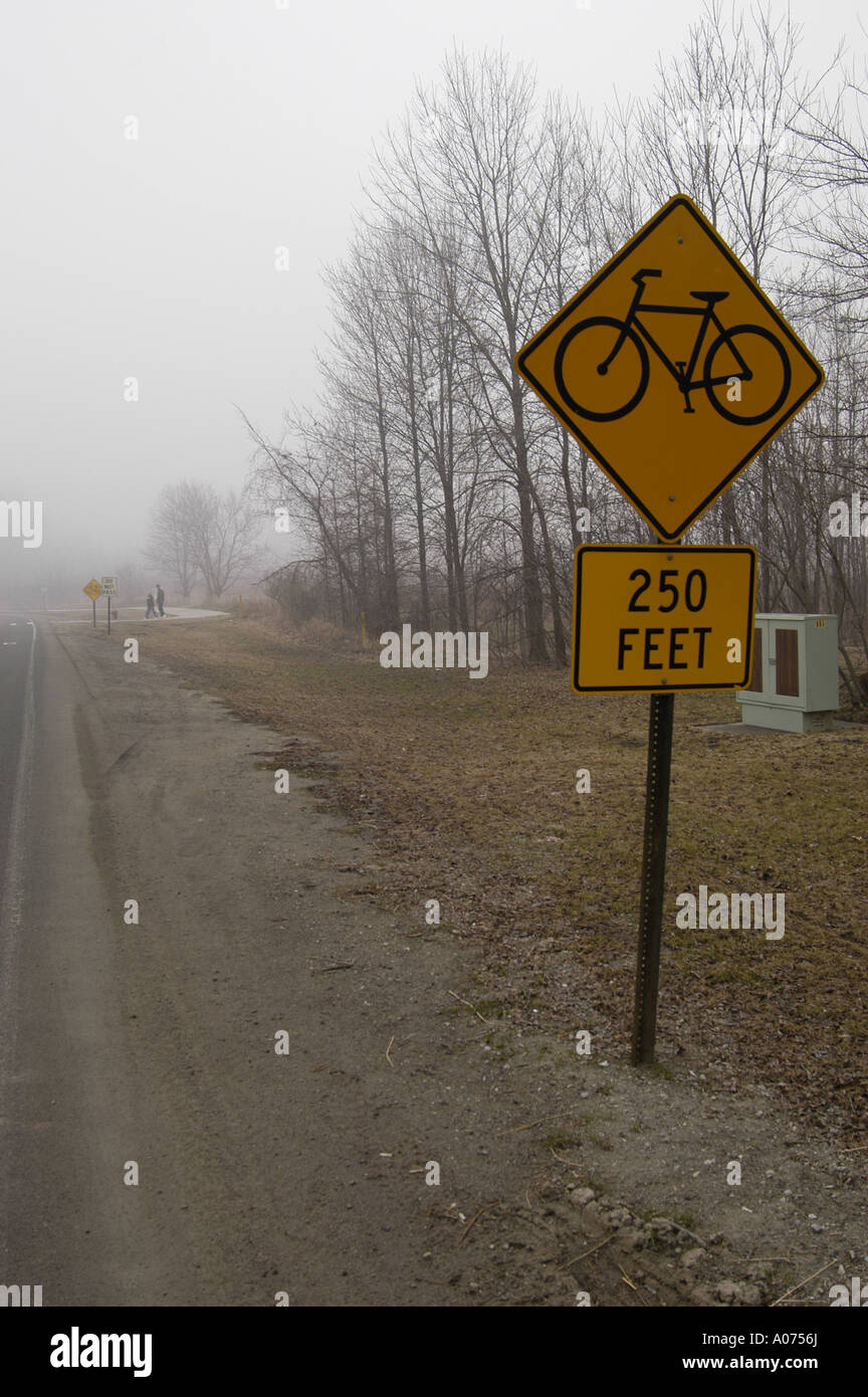 P13 142 Bicycle Crossing Signs On Foggy Day Show Visibility of about 250 Feet - Stock Image