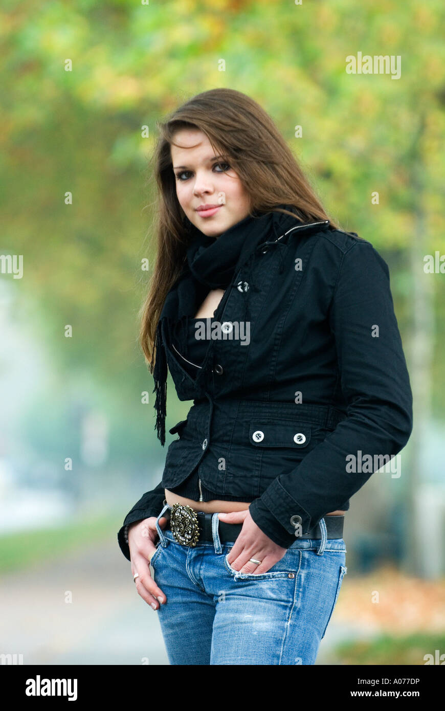 16 Year Old Girl With Brown Hair Outside In Autumn Stock