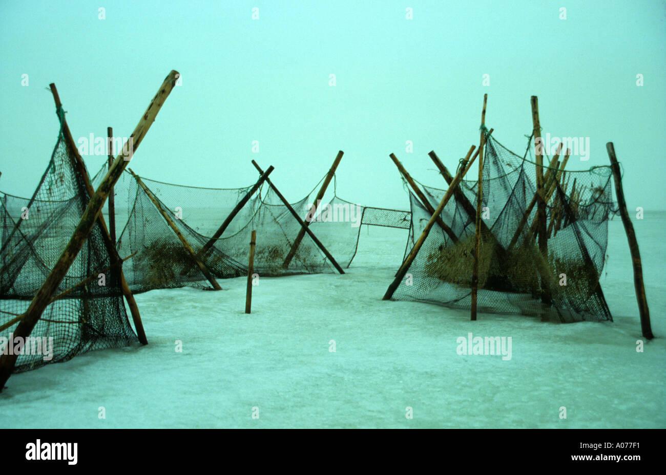 Watten stock photos watten stock images alamy for Frozen fishing pole
