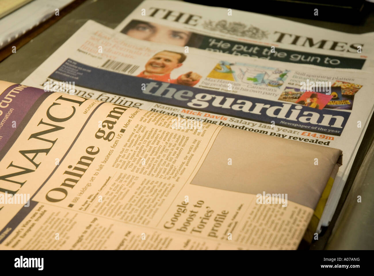 A selection of British broadsheet newspapers on a table in London England Stock Photo