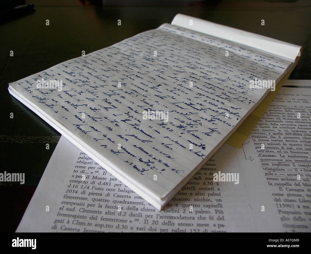 Notes handwriting on a desktop - Stock Image