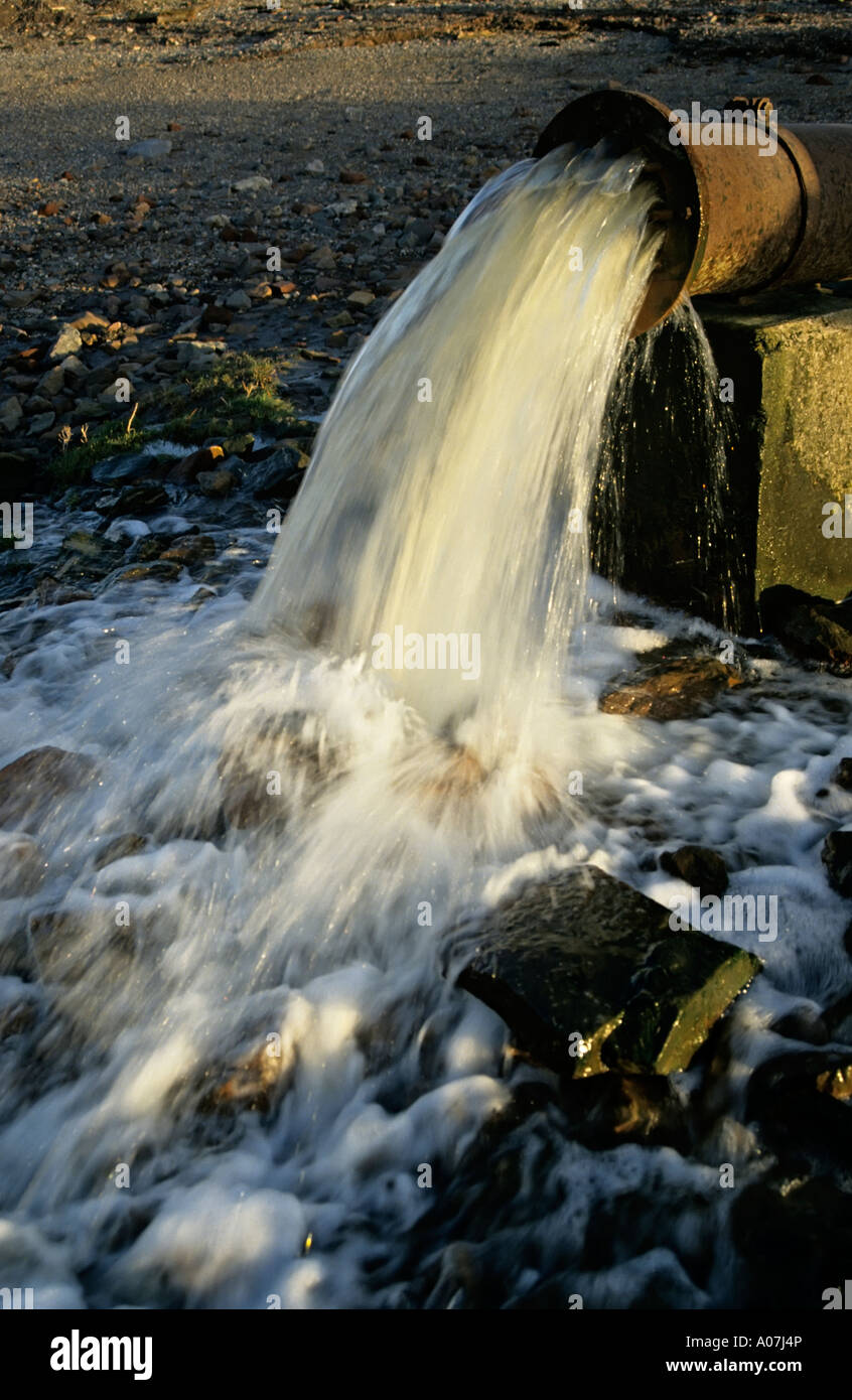 Pipe discharging waste water into River Severn England UK - Stock Image
