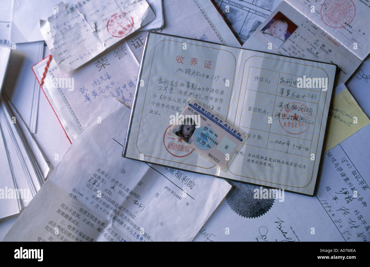 The relevant Passport and Papers and documents required for the adoption of a Chinese orphan by a family living in New York USA - Stock Image