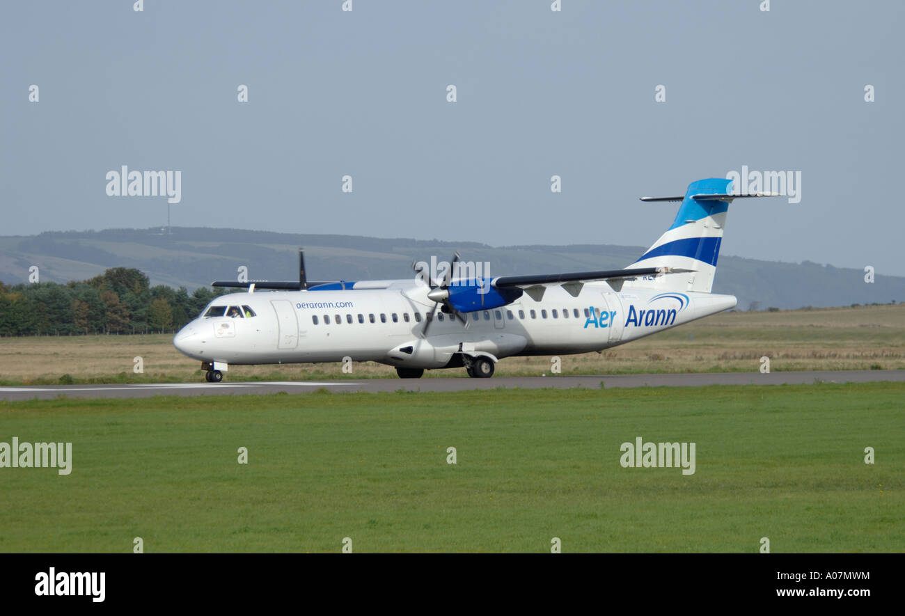 Aerospatiale -72-201ATR of Aer.Arann preparing to depart Inverness, Dalcross Airport. Scotland.  XAV 3985-379 - Stock Image